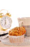Banana nut muffin with alarm clock. Freshly baked banana nut muffin with coffee, alarm clock and crossword puzzle Royalty Free Stock Images
