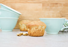 Banana nut muffins. With pretty teal blue teacups Stock Photo