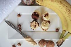 Banana, nuts, chocolate, walnuts. Healthy diet meal. Banana sweet. Royalty Free Stock Image