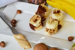 Banana, nuts, chocolate, walnuts. Healthy diet meal. Banana sweet. Royalty Free Stock Photography