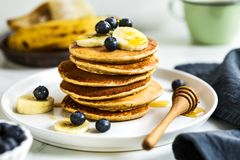 Banana, Oat Pancakes with fresh Blueberry and Banana stock images