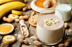 Banana oat peanut butter smoothies Stock Images
