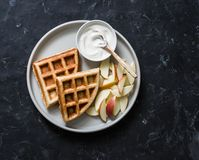 Banana oatmeal waffles with apple and yogurt on a dark background, top view. Delicious breakfast, dessert royalty free stock photography