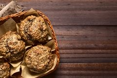 Banana Oatmeal Walnut Muffins. Fresh homemade banana oatmeal and walnut muffins in basket, photographed overhead with natural light Selective Focus, Focus on the stock photography