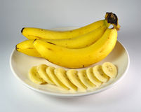 Banana On White Plate Stock Image