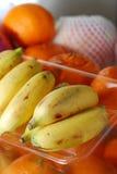 Banana Orange. Banana in plastic tray with Orange Stock Photo