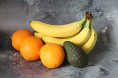 Banana, orange and avocado Stock Photo
