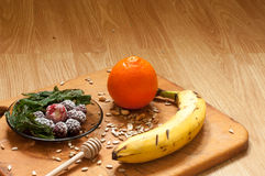 Banana, orange,frozen strawberries blackberries and seeds vivid smoothie ingredients on the background Stock Images