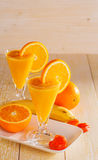 Banana and orange smoothie Stock Image