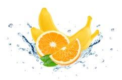 Banana and orange splash water. Isolated on white Stock Image