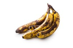 Banana. Over ripe bananas isolated on white with shadows royalty free stock image