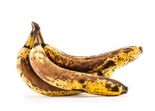 Banana. Over ripe bananas isolated on white with shadows stock photography