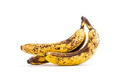 Banana. Over ripe bananas isolated on white with shadows stock images