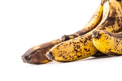 Banana. Over ripe bananas on white with shadows stock images