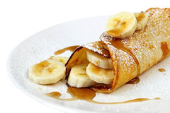 Banana Pancake. Or crepe, with maple syrup and powdered sugar stock photography