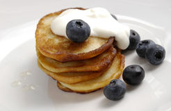 Banana pancakes with cream and blueberries Stock Image