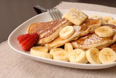 Banana pancakes with a fork Royalty Free Stock Photo