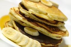 Banana Pancakes with Maple Syrup. Closeup of a stack of fresh banana pancakes with a maple syrup Stock Photos