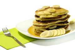Banana Pancakes with Maple Syrup. Closeup of a stack of fresh banana pancakes with a maple syrup Stock Images