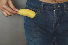 Banana in pants pocket. royalty free stock images
