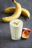 Banana and passion fruit smoothie in a glass Stock Photos