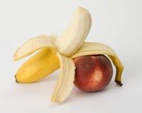 Banana and peach Royalty Free Stock Photos