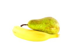 Banana and pear on a white background Stock Image