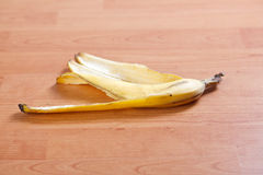 Banana peel. On wooden background Royalty Free Stock Photography