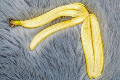 Banana peel on the carpet. In backgrounds Royalty Free Stock Photos