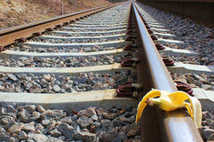 Banana peel on railway.  Train Sabotage  humoristic conceptual image Stock Image