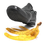 Banana peel and shoe Royalty Free Stock Photography