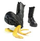 Banana peel and shoe Stock Image