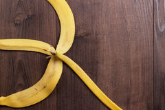 Banana peel on the wooden background Stock Photography