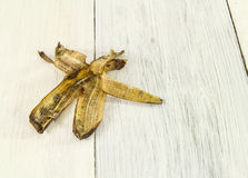 Banana peel on wooden background Stock Images