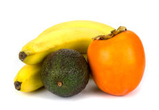 Banana persimmon and avocado Stock Images