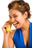 Banana Phone 2. Cute Girl Holding Banana as a Phone and Laughing Stock Images