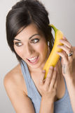Woman Smiles Acting Like Using Banana Phone Stock Photos