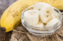 Banana Pieces in a bowl. (close-up shot) with some fresh fruits Stock Photography