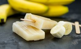 Banana Popsicles on a slate slab Royalty Free Stock Photography