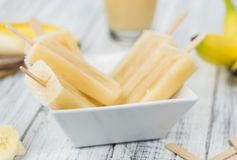 Banana Popsicles on vintage background Stock Images