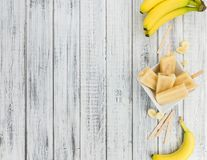 Banana Popsicles on wooden background Stock Image