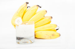 Banana products on white background. Bananas, banana smoothie isolated on white background from above Royalty Free Stock Photography