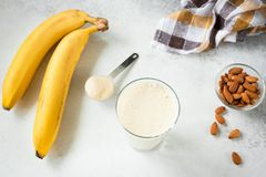 Banana Protein Shake Or Smoothie In Glass stock photography