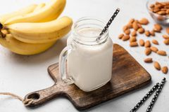Free Banana Protein Smoothie In Drinking Glass Stock Photos - 125807683