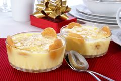 Banana Pudding. Old fashioned banana pudding with cookies, banana chunks, and pudding in cut crystal dishes on Christmas decorated table Stock Photography