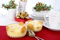 Banana Pudding. Old fashioned banana pudding with cookies, banana chunks, and pudding in cut crystal dishes on Christmas decorated table Stock Photos
