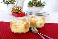 Banana Pudding. Old fashioned banana pudding with cookies, banana chunks, and pudding in cut crystal dishes on Christmas decorated table Stock Image