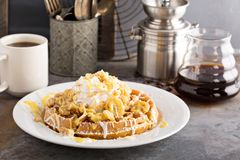 Banana pudding waffle with whipped cream. And cake crumbs stock photography
