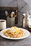 Banana pudding waffle with whipped cream. And cake crumbs royalty free stock photography