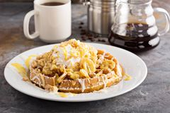 Banana pudding waffle with whipped cream. And cake crumbs stock images